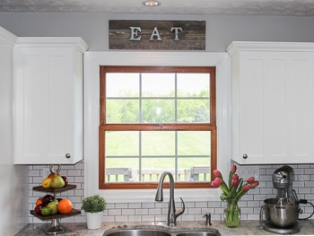 Galvanized metal letter and barn wood sign